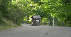 Small ticket booth at the entry of the conservation area at Belfountain, Canada Stock Footage