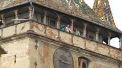 Tourists standing in the balcony of the Clock Tower, Sighisoara Stock Footage