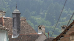 Chimneys and roofs of buildings in Sighisoara Stock Footage