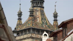 The mosaic roof and small corner turrets of the Clock Tower, Sighisoara Stock Footage
