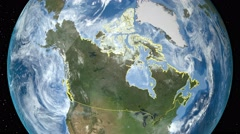 Night to day - rotating Earth. Zoom in on Canada outlined Arkistovideo