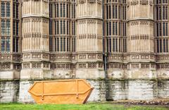Closeup photo of Westminster palace with big garbage container, London - stock photo