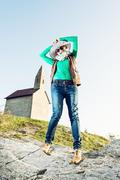 Young joyful woman posing with stylish hat. Cowboy style. Old romanesque chur - stock photo