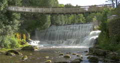 Wooden bridge over the waterfall at Belfountain, Canada Stock Footage