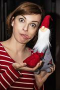 Crazy young woman posing with Santa Claus, Christmas scene - stock photo