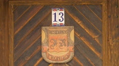 Stock Video Footage of Fronius Residence sign and the house number sign on a  wooden door, Sighisoara