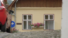 House with colorful flowers on a street in Sighisoara Stock Footage