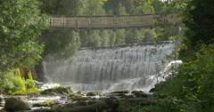 Wonderful wooden bridge over the waterfall at Belfountain, Canada Stock Footage