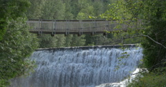 Bridge made of wood over the waterfall at Belfountain, Canada Stock Footage