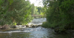 People taking pictures on the bridge over the waterfall at Belfountain, Canada Stock Footage