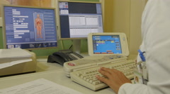 Radiology. Radiologist scanning patient, focus to hands tapping on keyboard. Stock Footage