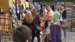 Tourists buying souvenirs on a street in Sighisoara Stock Footage