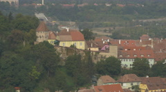 The old wall, a tower and buildings in seen from above, Sighisoara Stock Footage