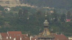 The Clock Tower with its mosaic roof seen from above, Sighisoara Stock Footage