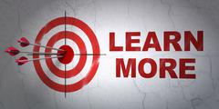 Learning concept: target and Learn More on wall background Stock Illustration