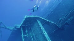 Divers exploring Zenobia shipwreck Stock Footage