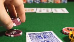 Player twirls a playing chips in the hand (close up) Stock Footage