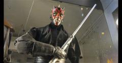 """Star wars character """"Darth Maul"""" Holding his double lightsaber Stock Footage"""