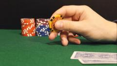 Player twirls a playing chip in the hand (side view) Stock Footage