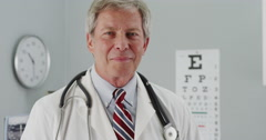 Successful Senior doctor smiling at camera Stock Footage