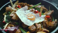 Cooked meat meal with vegetables, egg in a pan Stock Footage