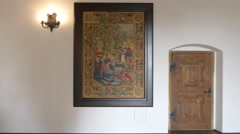 Stock Video Footage of A framed decorative rug, a wooden door and a lamp in Fagaras fortress