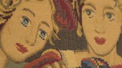 Decorative rug representing two women in Fagaras fortress - stock footage