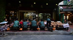 Street foot massage in down town of Bangkok city Stock Footage