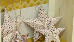 Giant Christmas Paper Stars And Christmas Candles On A Fake Fireplace - stock footage
