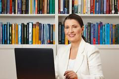 Smiling consultant counselor adviser library Stock Photos