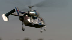 Helicopter flies against backdrop of forest Stock Footage