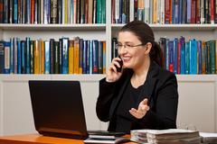 businesswoman financial adviser telephone call - stock photo