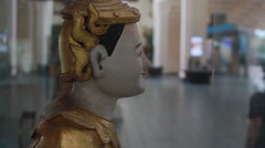 Asian Statue in Large Hotel Lobby- Pan to Left with Follow Focus (B-Roll Shot) Stock Footage