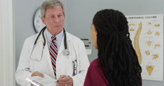 Senior doctor and Young nurse discussing patient's results Stock Footage