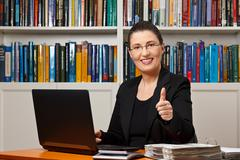 Financial consultant adviser thumbs up - stock photo