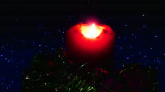 Christmas gifts with a lighted candle - stock footage