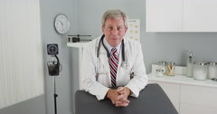 Senior doctor looking at camera smiling Stock Footage