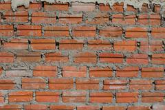 red brick wall texture allowing the picture to be tiled for background - stock photo