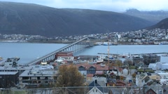 Tromso city island in late autumn with buildings, traffic and blue fjord Stock Footage