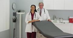 Two doctors smiling at the camera Stock Footage