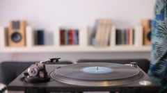 A man starting a retro record player Stock Footage