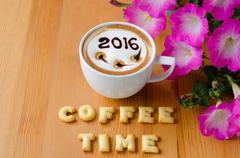 hot coffee with foam milk art 2016 pattern - stock photo