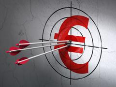 Currency concept: arrows in Euro target on wall background Piirros
