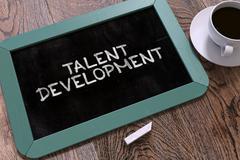 Talent Development Handwritten on Chalkboard - stock illustration