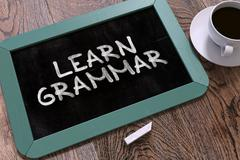 Learn Grammar - Chalkboard with Hand Drawn Text - stock illustration
