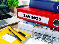 Savings on Red Ring Binder. Blurred, Toned Image - stock illustration