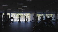 Footage of people's silhouette exercising and training in the gym Stock Footage