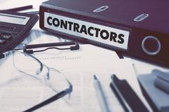 Stock Photo of Contractors on Office Folder. Toned Image
