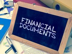 Stock Illustration of Hand Drawn Financial Documents Concept on Small Chalkboard