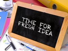 Stock Illustration of Time for Fresh Idea Handwritten by White Chalk on a Blackboard